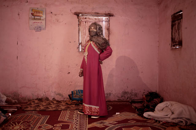 In this March 31, 2019 photo, Umm Yasser, the first female Bedouin guide from the Hamada tribe, poses for a photograph in her home in Wadi Sahw, Abu Zenima, South Sinai, Egypt. Four Bedouin women are for the first time leading tours in Egypt's Sinai Peninsula, breaking new ground in their deeply conservative community, where women almost never work outside the home or interact with outsiders. The tourists can only be women, and the tours can't go overnight. Each day before the sun sets, the group returns to the Hamada's home village in Wadi Sahu, a narrow desert valley. (AP Photo/Nariman El-Mofty) (AP Photo/Nariman El-Mofty)
