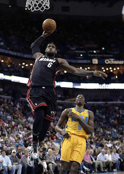Miami Heat forward LeBron James (6) goes to the basket in front of New Orleans Hornets forward Al-Farouq Aminu (0) during the first half of an NBA basketball game in New Orleans, Friday, March 29, 2013. (AP Photo/Gerald Herbert)