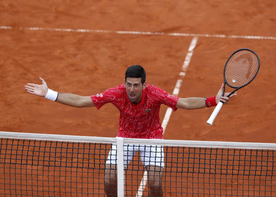Serbia's Novak Djokovic reacts during a tennis doubles match with Jelena Jankovic against Serbia's Nenad Zimonjic and Olga Danilovic during the Adria Tour charity tournament, in Belgrade, Serbia, Friday, June 12, 2020. Serbian tennis player Novak Djokovic set up a series of tennis tournaments in the Balkan region while the sport is suspended amid the coronavirus pandemic. (AP Photo/Darko Vojinovic)