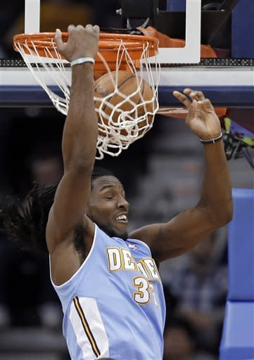 Denver Nuggets' Kenneth Faried dunks against the Cleveland Cavaliers in the second quarter of an NBA basketball game Saturday, Feb. 9, 2013, in Cleveland. (AP Photo/Mark Duncan)