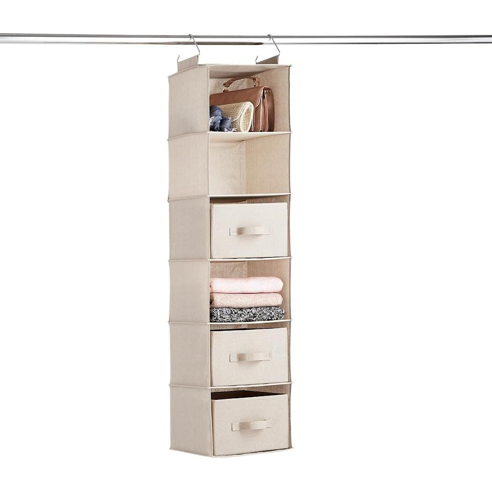 """<p>We love that this <a href=""""https://www.popsugar.com/buy/6-Compartment-Hanging-Sweater-Organizer-541775?p_name=6-Compartment%20Hanging%20Sweater%20Organizer&retailer=containerstore.com&pid=541775&price=25&evar1=casa%3Auk&evar9=47128586&evar98=https%3A%2F%2Fwww.popsugar.com%2Fhome%2Fphoto-gallery%2F47128586%2Fimage%2F47128635%2F6-Compartment-Hanging-Sweater-Organizer&list1=shopping%2Corganization%2Cclosets%2Chome%20organization%2Chome%20shopping&prop13=api&pdata=1"""" rel=""""nofollow"""" data-shoppable-link=""""1"""" target=""""_blank"""" class=""""ga-track"""" data-ga-category=""""Related"""" data-ga-label=""""https://www.containerstore.com/s/closet/storage-hanging-bags/taupe-6-compartment-hanging-sweater-organizer/12d?productId=11010958"""" data-ga-action=""""In-Line Links"""">6-Compartment Hanging Sweater Organizer</a> ($25) has drawers.</p>"""