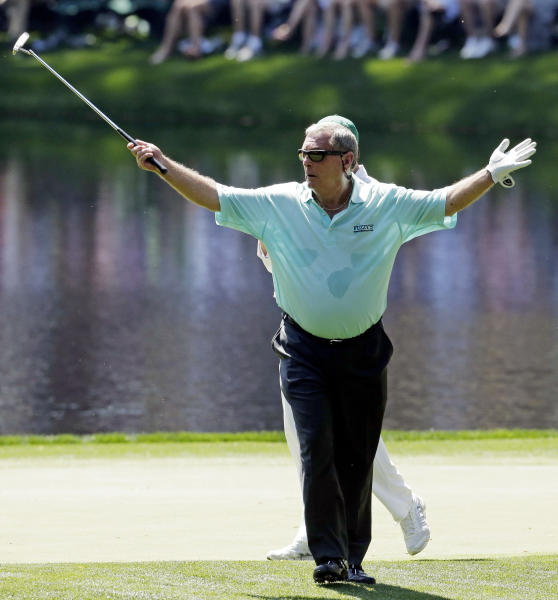 Fuzzy Zoeller acknowledges applauds after putting on the eighth hole during the par three competition before the Masters golf tournament Wednesday, April 10, 2013, in Augusta, Ga. (AP Photo/Charlie Riedel)