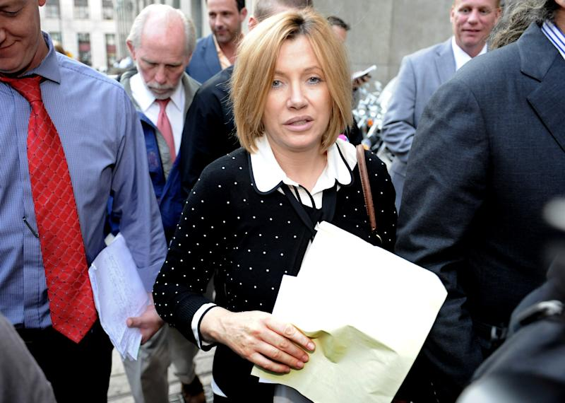 Anna Gristina exits Manhattan criminal court, Tuesday, Sept. 25, 2012, in New York.The suburban mother of four charged with moonlighting as a multimillion-dollar madam pleaded guilty Tuesday to promoting prostitution.The Scotland-born Anna Gristina made the plea in Manhattan court. The judge said she'll be sentenced Nov. 20 to time served and probation as part of a plea deal. (AP Photo/ Louis Lanzano)