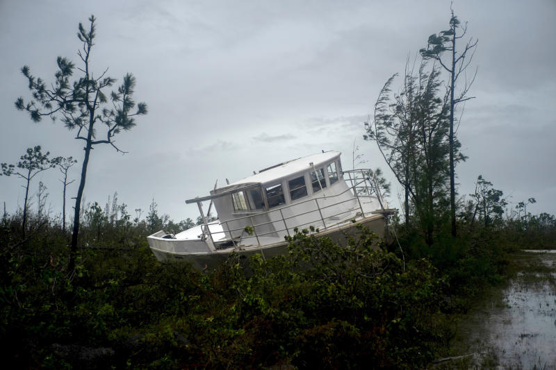 A boat thrown onshore by the Hurricane Dorian lays stranded next to a highway near Freeport, Grand Bahama, Bahamas, Tuesday Sept. 3, 2019. (Photo: Ramon Espinosa/AP)