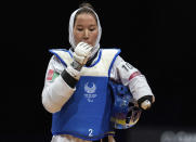 Zakia Khudadadi of Afghanistan stands after fighting against Viktoriia Marchuk Ukraine in the Women's 49kg Taekwondo Repecharge at the Tokyo 2020 Paralympic Games in Makuhari, Japan, Thursday, Sept. 2, 2021. (Joe Toth for OIS via AP)