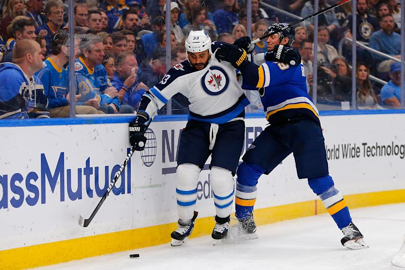 ST. LOUIS, MO - APRIL 20: Jay Bouwmeester #19 of the St. Louis Blues knocks Dustin Byfuglien #33 of the Winnipeg Jets off the puck in Game Six of the Western Conference First Round during the 2019 NHL Stanley Cup Playoffs at the Enterprise Center on April 20, 2019 in St. Louis, Missouri. (Photo by Dilip Vishwanat/Getty Images)