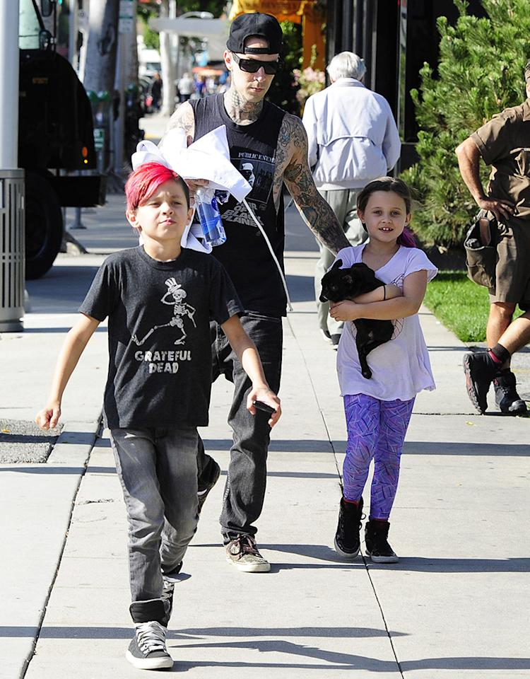 When you think of a dad taking his kids to private dance class in Beverly Hills, you probably aren't imagining Travis Barker, but that's what the tattooed rocker was doing on Wednesday when he was snapped with kids Landon, 9, and Alabama, 7. (5/1/2013)