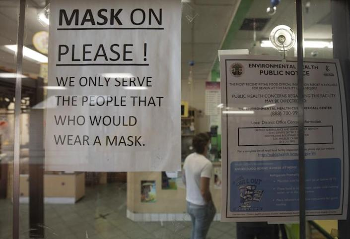 LOS ANGELES, CA - JULY 17: A sign at a Chinatown business reminds customers to wear a mask. The LA County mask mandate will go into effect at 11:59 p.m. Saturday, July 17, 2021 requiring masks be worn indoors with the exception that masks can be removed if dining in a restaurant. Photographed in Chinatown on Saturday, July 17, 2021 in Los Angeles, CA. (Myung J. Chun / Los Angeles Times)