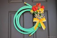 "<p>Gardening tools don't have to be confined to the flowerbed—they can even earn a starring spot on your front door, when arranged like so. Pay tribute to your blooming summer florals with this hose-and-glove-adorned wreath. </p><p><strong>Get the tutorial at <a href=""https://www.createcraftlove.com/garden-hose-spring-wreath/"" rel=""nofollow noopener"" target=""_blank"" data-ylk=""slk:Create. Craft. Love"" class=""link rapid-noclick-resp"">Create. Craft. Love</a>.</strong></p><p><strong><a class=""link rapid-noclick-resp"" href=""https://www.amazon.com/Gilmour-25034075-Commercial-Hose-Feet/dp/B000KL6QYI/?tag=syn-yahoo-20&ascsubtag=%5Bartid%7C10050.g.4395%5Bsrc%7Cyahoo-us"" rel=""nofollow noopener"" target=""_blank"" data-ylk=""slk:SHOP GARDEN HOSES"">SHOP GARDEN HOSES</a><br></strong></p>"