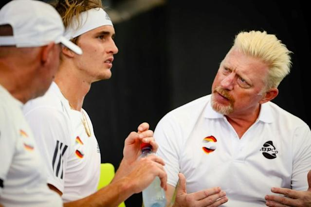 Alexander Zverev (2nd L) used to be coached by German legend Boris Becker (R). (AFP Photo/Patrick HAMILTON)
