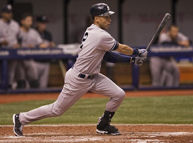 New York Yankees designated hitter Derek Jeter hits an RBI-single off Tampa Bay Rays closer Jake McGee to drive in the go-ahead run during the ninth inning of a baseball game Saturday, Aug. 16, 2014, in St. Petersburg, Fla. The Yankees defeated the Rays 3-2. (AP Photo/Steve Nesius)