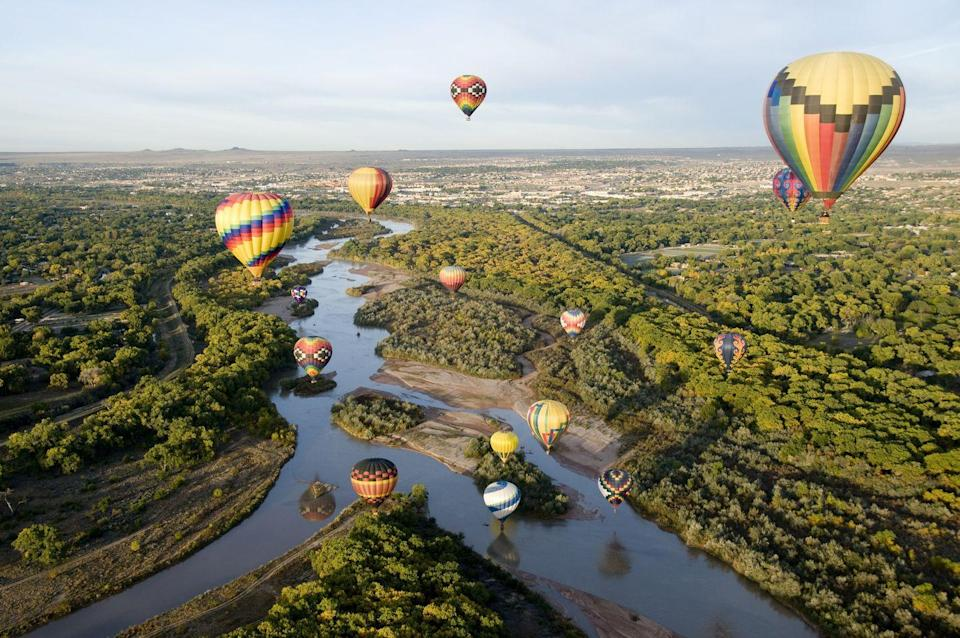 """<p>Nestled between the Rio Grande and the Sandia Mountains, Albuquerque has the ideal mix of urban life and stunning natural wonders. Traditional adobe buildings and the <a href=""""https://sanfelipedeneri.org/"""" rel=""""nofollow noopener"""" target=""""_blank"""" data-ylk=""""slk:San Felipe de Neri Church"""" class=""""link rapid-noclick-resp"""">San Felipe de Neri Church</a> in the city's Old Town give insight into the past while elaborate bike trails cut through the high-desert landscape. Each fall, visitors from around the world gather at New Mexico's capital to see the sky filled with colorful hot-air balloons for the International Balloon Fiesta. <br></p><p>Can't miss beautiful places: <a href=""""https://lospoblanos.com/"""" rel=""""nofollow noopener"""" target=""""_blank"""" data-ylk=""""slk:Los Poblanos Historic Inn and Farm"""" class=""""link rapid-noclick-resp"""">Los Poblanos Historic Inn and Farm</a>, <a href=""""https://hotelandaluz.com/"""" rel=""""nofollow noopener"""" target=""""_blank"""" data-ylk=""""slk:Hotel Andaluz"""" class=""""link rapid-noclick-resp"""">Hotel Andaluz</a>, and the <a href=""""https://indianpueblo.org/"""" rel=""""nofollow noopener"""" target=""""_blank"""" data-ylk=""""slk:Indian Pueblo Cultural Center"""" class=""""link rapid-noclick-resp"""">Indian Pueblo Cultural Center</a></p>"""