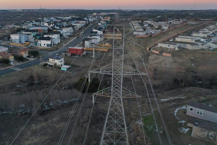 An aerial view from a drone shows electrical lines running through a neighborhood on February 19, 2021 in Austin, Texas. Amid days of nationwide frigid winter storms in which 58 people died, more than 4 million Texans were without power for much of the past week, with about 13 million Texans being forced to boil tap water in the aftermath of the strain on infrastructure. (Photo by Joe Raedle/Getty Images)