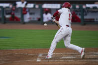 Cincinnati Reds second baseman Kyle Farmer (52) hits a two run double during the second inning of a baseball game against the Kansas City Royals at Great American Ballpark in Cincinnati, Tuesday, Aug. 11, 2020. (AP Photo/Bryan Woolston)