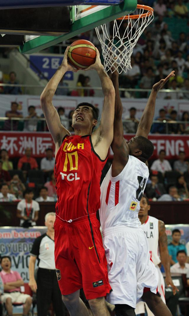 Zhang Zhaoxu of China (L) goes for a basket as Maton Barros of Angola tries to block during the FIBA Stankovic Continental Cup basketball second leg tournament in Guangzhou, south China's Guangdong province on August 9, 2011. China beat Angola 64-54 to end a seven-game losing streak and finishing third in the second leg of the tournament having finished fourth in the first leg last week at Haining. AFP PHOTO (Photo credit should read STR/AFP/Getty Images)