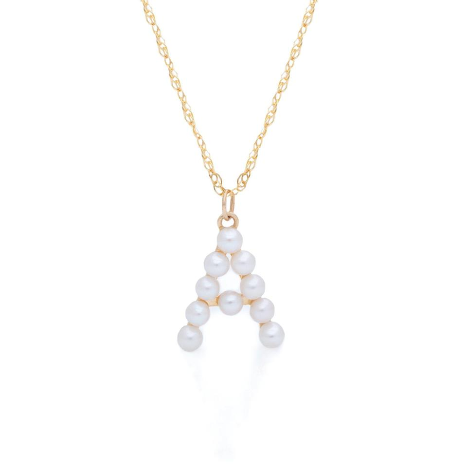 """<p>stoneandstrand.com</p><p><strong>$230.00</strong></p><p><a href=""""https://www.stoneandstrand.com/collections/necklaces/products/pearly-initial-necklace?variant=32412113535073"""" rel=""""nofollow noopener"""" target=""""_blank"""" data-ylk=""""slk:Shop Now"""" class=""""link rapid-noclick-resp"""">Shop Now</a></p><p>For the gal who can't get enough pearl jewelry (raises both hands), this pearl initial necklace is a reimagined classic that looks lovely when layered with other dainty confections or worn on its own. <br></p>"""