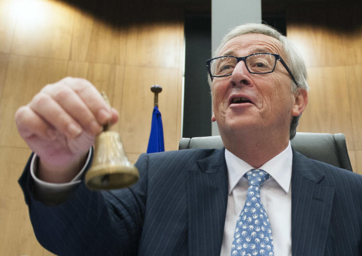 New European Commission chief Jean-Claude Juncker rings the bell on November 5, 2014 before the first meeting with commission colleagues in Brussels (AFP Photo/John Thys)