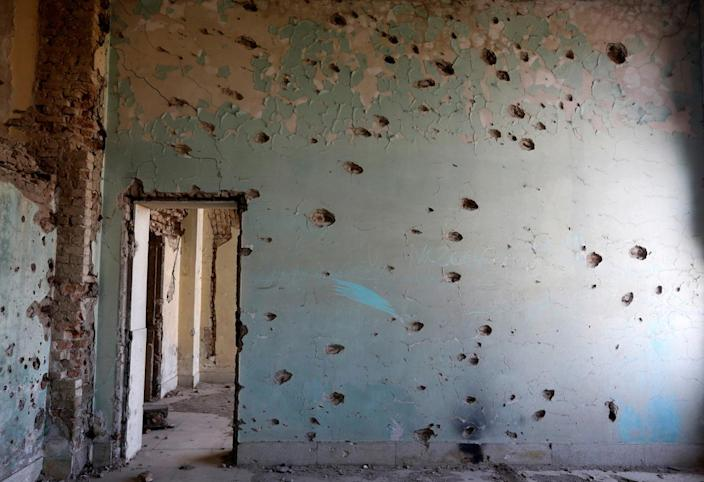 <p>A wall damaged by bullets is seen at Darul Aman Palace in Kabul, Afghanistan, June 5, 2016. (Omar Sobhani/Reuters) </p>
