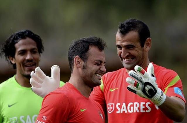 Portugal´s goalkeeper Beto (C) is teased by defender Bruno Alves (L) and goalkeeper Eduardo Carvalho (R) on May 30, 2012 in Praia del Rey near Obidos, central Portugal, during a training camp in preparation for the Euro 2012 football championship, which will take place in Poland and Ukraine from June 8 to July 1. AFP PHOTO/ FRANCISCO LEONGFRANCISCO LEONG/AFP/GettyImages