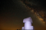 <p>The Helmos Observatory in Greece sits under the light show (Reuters) </p>