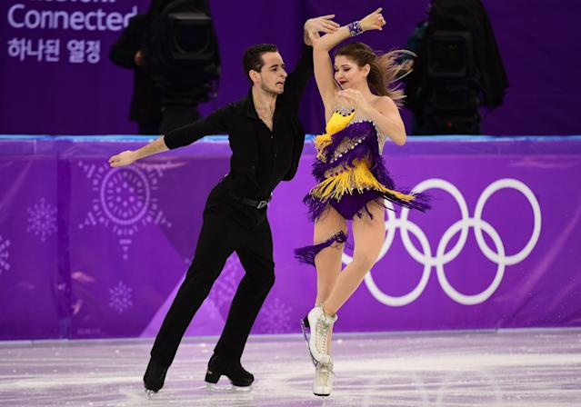 <p>Ukraine's Maxim Nikitin and Alexandra Nazarova perform during the ice dance short dance of the figure skating event during the Pyeongchang 2018 Winter Olympic Games at the Gangneung Ice Arena in Gangneung on February 19, 2018. / AFP PHOTO / Roberto SCHMIDT </p>