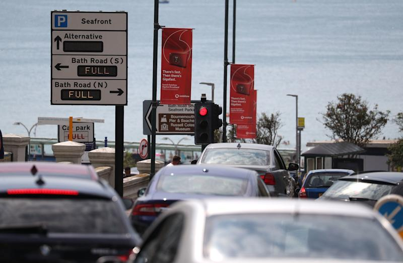 Cars queue up as they head down towards the sea front at Bournemouth beach (PA)
