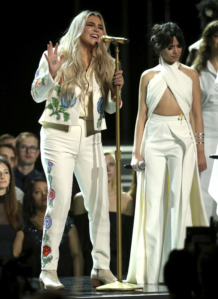 """FILE - Kesha, left, performs """"Praying"""" with Camila Cabello at the 60th annual Grammy Awards in New York on Jan. 28, 2018. (Photo by Matt Sayles/Invision/AP)"""