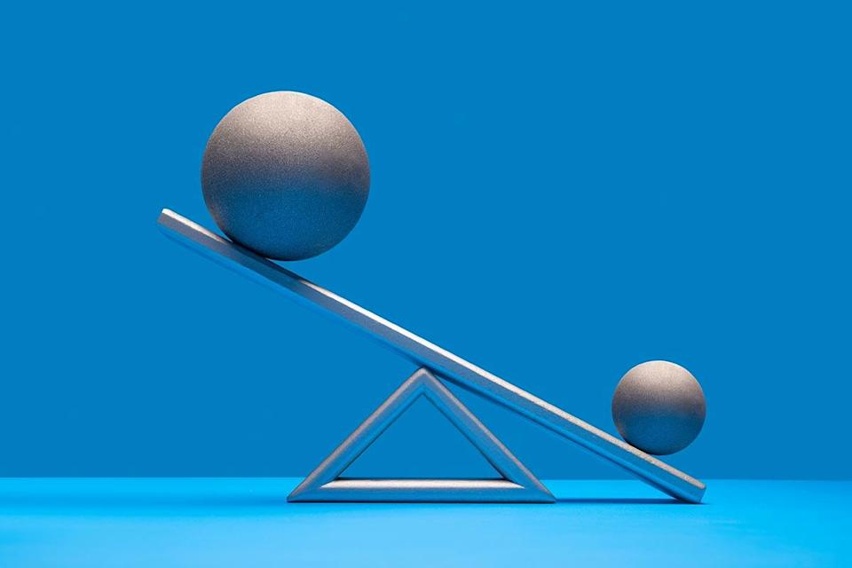 With little evidence, some people believe a certain probiotic can increase testicle size.Pictured: One large and one smaller silver ball on seesaw weight scale, larger ball on high side, blue surface and background