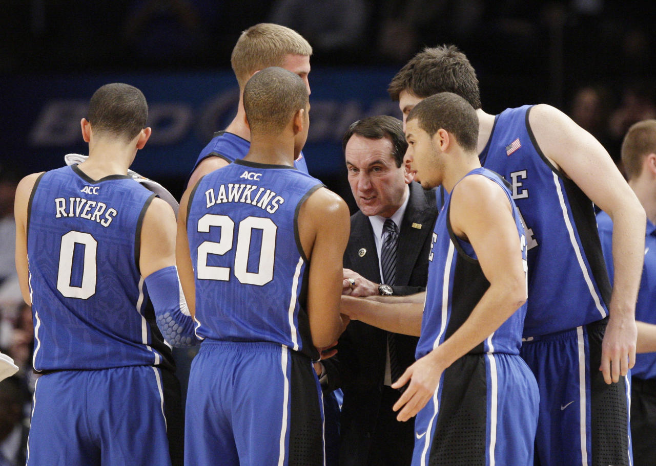 Duke coach Mike Krzyzewski talks to his team during a timeout in the first half of an NCAA college basketball game against Duke on Tuesday, Nov. 15, 2011, in New York. (AP Photo/Frank Franklin II)