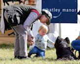 <p>Princess Anne and her granddaughter, Mia Tindall, meet a dog at the Whatley Manor International Horse Trials.</p>
