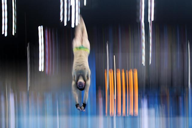 LONDON, ENGLAND - JULY 26: A diver in action during a training session ahead of the London Olympic Games at the Aquatics Centre in Olympic Park on July 26, 2012 in London, England. (Photo by Adam Pretty/Getty Images)