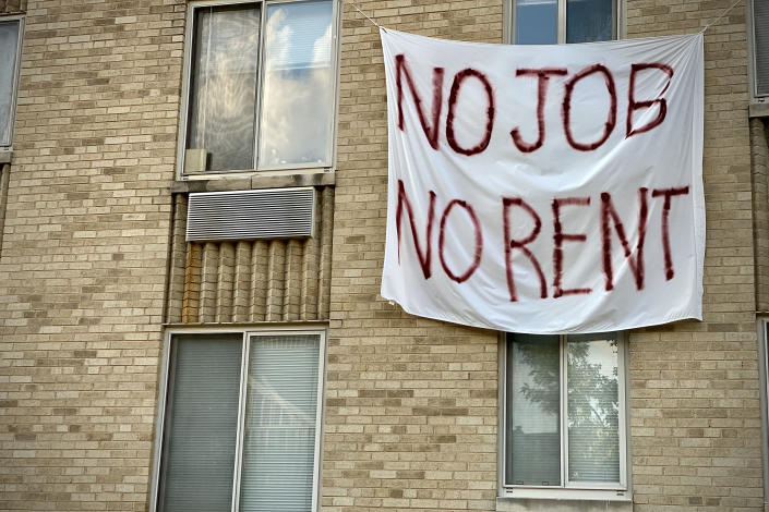 A banner against renters eviction reading no job, no rent is displayed on a controlled rent building in Washington, DC on August 9, 2020. (Photo by ERIC BARADAT/AFP via Getty Images)