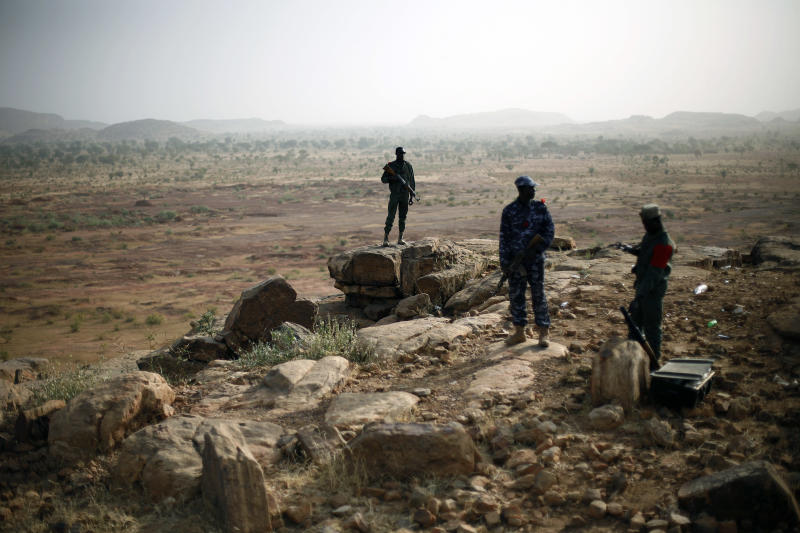 Malian troops man an observation post outside Sevare, some 620 kms (400 miles)  north of Mali's capital  Bamako Thursday, Jan. 24, 2013.  One wing of Mali's Ansar Dine rebel group has split off to create its own movement, saying that they want to negotiate a solution to the crisis in Mali, in a declaration that indicates at least some of the members of the al-Qaida-linked group are searching for a way out of the extremist movement in the wake of French airstrikes. (AP Photo/Jerome Delay)