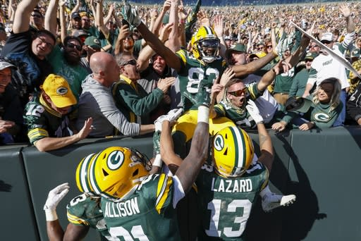 Green Bay Packers' Marquez Valdes-Scantling celebrates his touchdown catch during the second half of an NFL football game against the Oakland Raiders Sunday, Oct. 20, 2019, in Green Bay, Wis. (AP Photo/Mike Roemer)