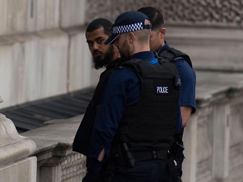 Police detain a man following an incident in Whitehall; a bag and three knives were found at the scene (EPA)