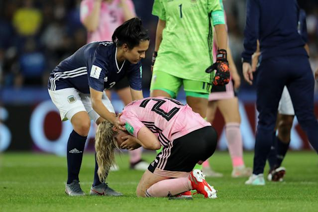 Argentina's Eliana Stabile (L) consoles Scotland's Erin Cuthbert after their group stage match on June 19 in Paris. (Getty)