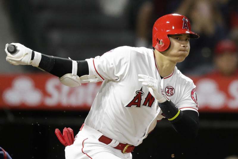 Los Angeles Angels' Shohei Ohtani, of Japan, watches a foul ball during the third inning of a baseball game against the Cleveland Indians in Anaheim, Calif., Monday, Sept. 9, 2019. (AP Photo/Chris Carlson)
