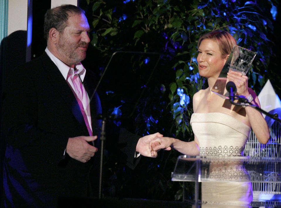 Harvey Weinstein, left, presents  Zellweger with an award at the Women in Film 2007 Crystal + Lucy Awards. (Photo: AP/Mark J Terrill)