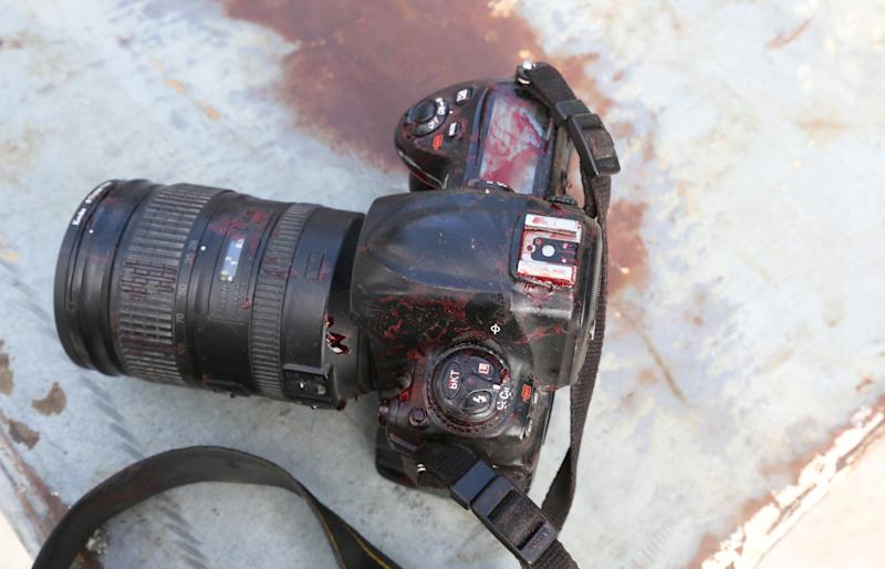 The blood stained camera of a photojournalist is seen in front of Dayah hotel in Somalia's capital Mogadishu, on Jan. 25.