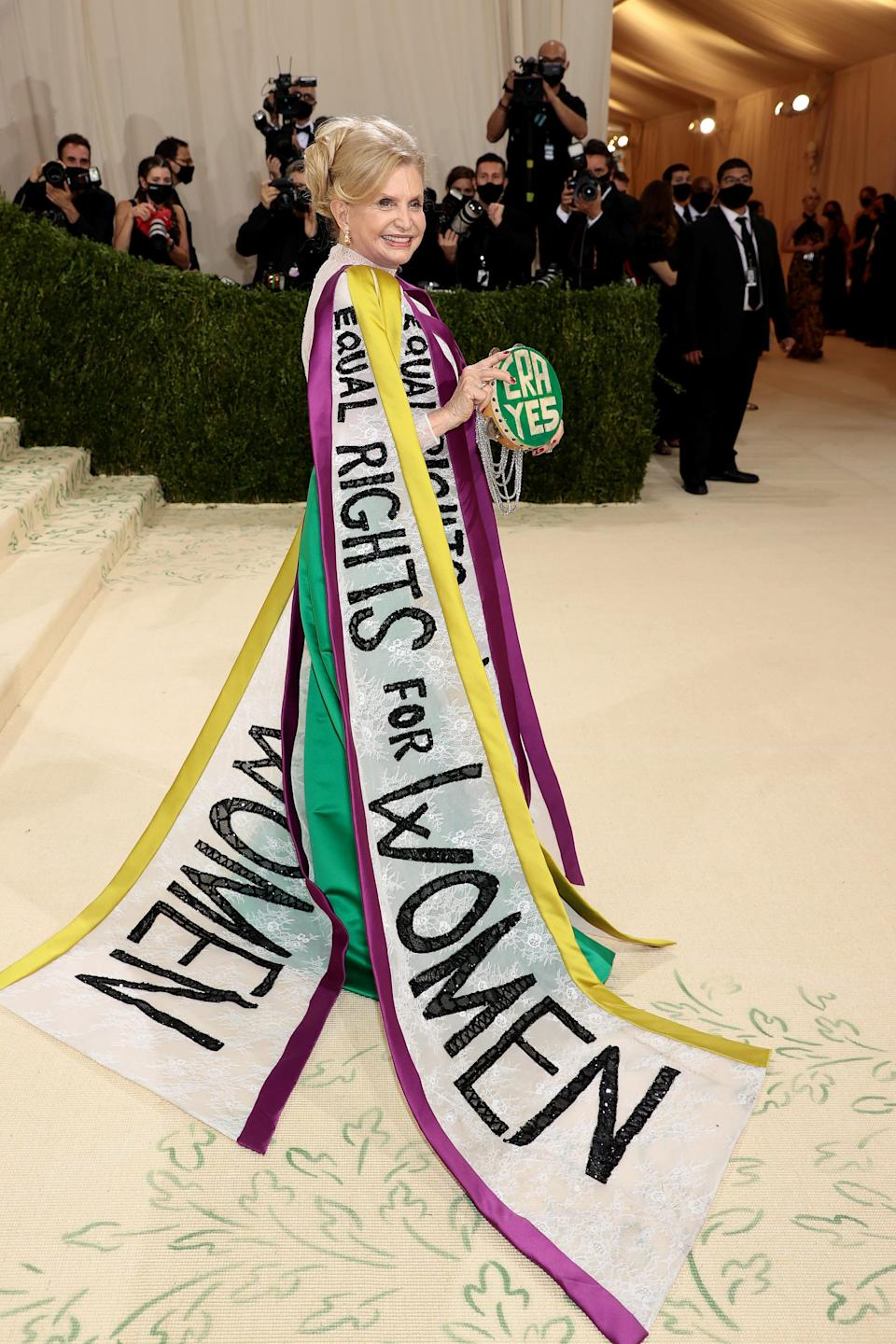 """Carolyn B. Maloney wears a dress that says """"equal rights for women"""" on it."""