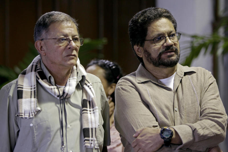 FILE - In this Dec. 6, 2012 file photo, Ivan Marquez, right, chief negotiator for Colombia's Revolutionary Armed Forces of Colombia, or FARC, and Ricardo Tellez arrive for peace talks with peace negotiators from Colombia's government in Havana, Cuba. While the angry rhetoric and bombs continue to fly back home, Colombian rebels and government negotiators in peace talks in the Cuban capital describe an increasingly collegial atmosphere and growing trust between otherwise mortal enemies. (AP Photo/Franklin Reyes, File)