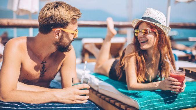 couple drinking at all inclusive resort vacation