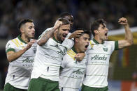 Portland Timbers forward Felipe Mora, second from right, and teammates celebrate his second-half goal against the Colorado Rapids during an MLS soccer match Wednesday, Sept. 15, 2021, in Portland, Ore. (Sean Meagher/The Oregonian via AP)