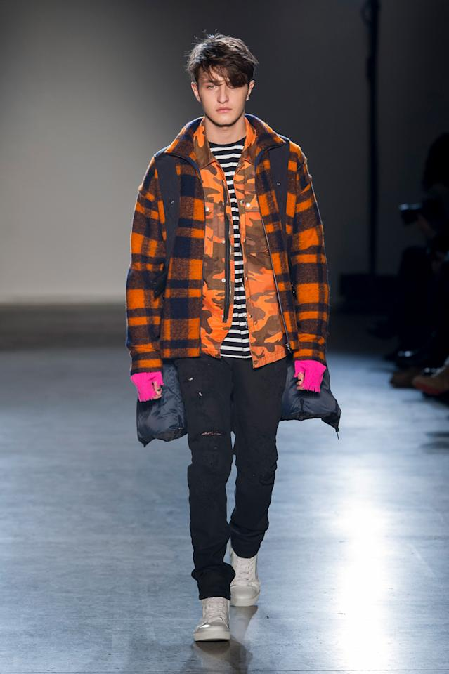 <p>Anwar, who also stars in the brand's Spring/Summer 2017 campaign with his sister Bella, pulls off a orange tartan, a camo jacket, and fingerless pink gloves. (Photo: ImaxTree) </p>