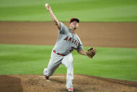 Los Angeles Angels starting pitcher Dylan Bundy throws against the Seattle Mariners during the seventh inning of a baseball game Thursday, Aug. 6, 2020, in Seattle. (AP Photo/Ted S. Warren)