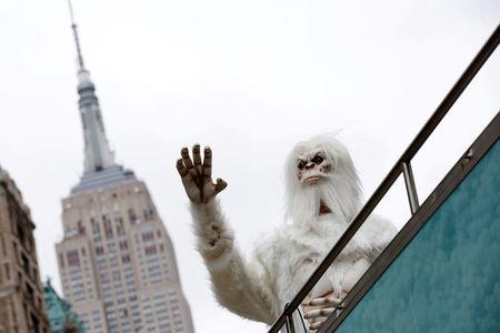 """FILE PHOTO: An actor dressed as a 'Yeti' waves from a tour bus during a promotional event for Travel Channel's """"Expedition Unknown: Hunt for the Yeti"""" in Manhattan"""