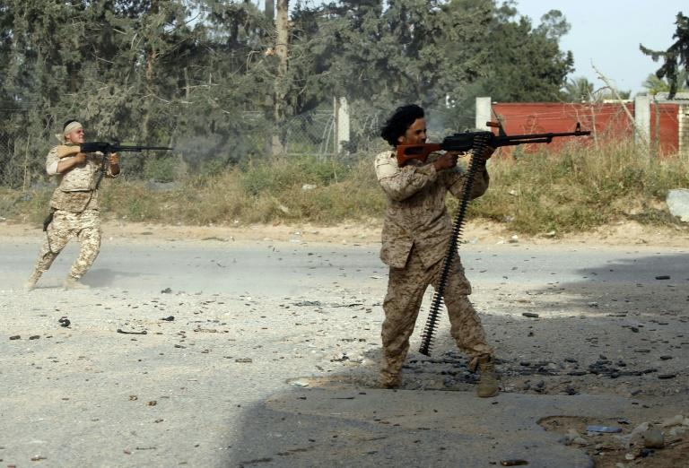 Libyan fighters loyal to the GNA fire towards forces loyal to strongman Khalifa Haftar south of Tripoli on Saturday