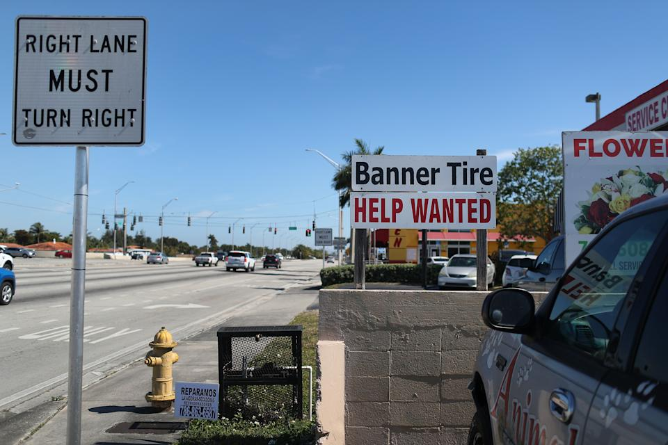 MIAMI, FLORIDA - FEBRUARY 04: A 'Help Wanted' sign is posted in front of a business on February 04, 2021 in Miami, Florida. The Labor Department announced weekly unemployment claims declined to 779,000 last week.  (Photo by Joe Raedle/Getty Images)