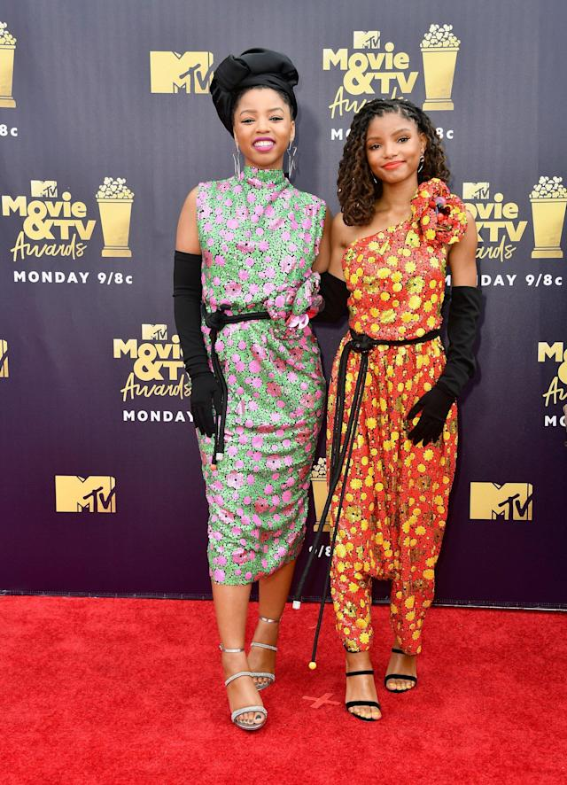 <p>Wearing matching floral gowns and Sophia Webster heels.</p>