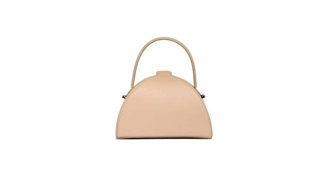 "<p>Mlouye was founded by Meb Rure, a former furniture designer from Turkey. She has slowly gained traction within the fashion community for her artful, sculptural handbags.<br><br>Pandora Bag, $495, champagne, <a href=""https://www.mlouye.com/collections/all/products/pandora-bag-champagne"" rel=""nofollow noopener"" target=""_blank"" data-ylk=""slk:mlouye.com"" class=""link rapid-noclick-resp"">mlouye.com</a> </p>"